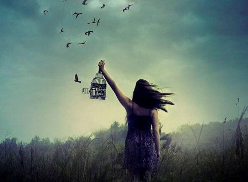 A girl freeing birds from a cage.