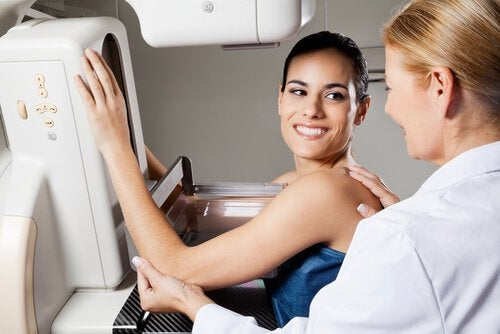 Doctor giving woman breast exam healthy breasts