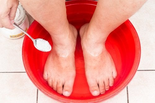 Feet soaking in water with baking soda to treat nail fungus