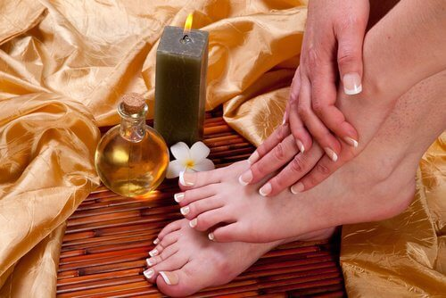 Woman treating her calluses with castor oil and apple cider vinegar
