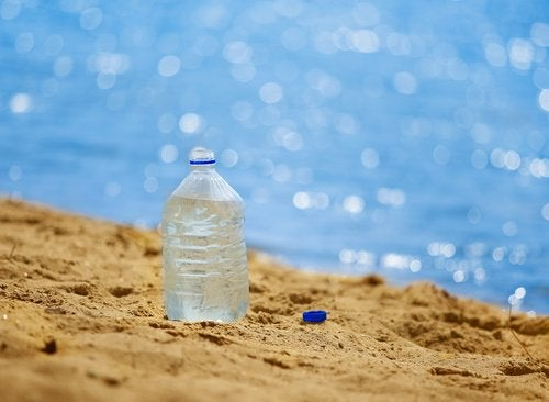 A water bottle on the beach.
