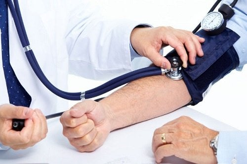 Doctor taking blood pressure.