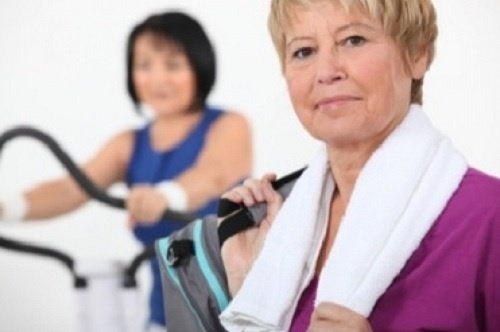 An older woman ready to exercise at the gym.