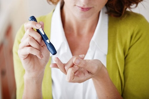 A woman checking her insulin levels.