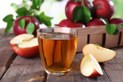 A glass of apple cider vinegar.