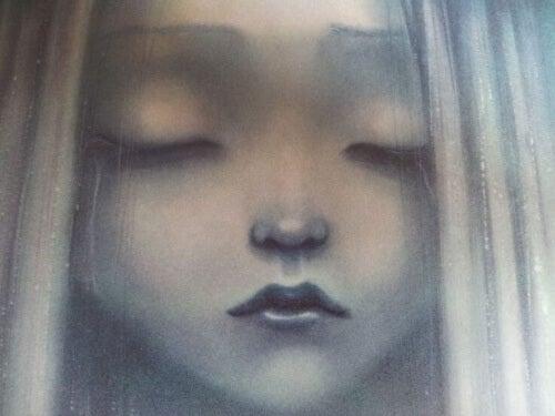 chica-triste-con-los-ojos-cerrados-500x375