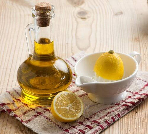 Lemon juice and olive oil sitting on a table