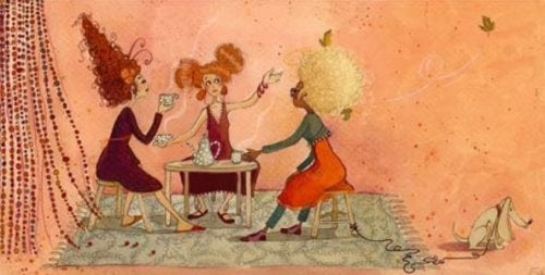 Three ladies drinking coffee together.