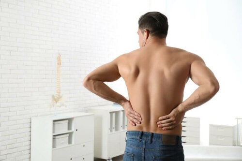 A man touching his low back.