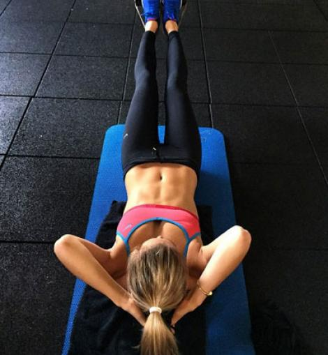 A woman working out her abs.