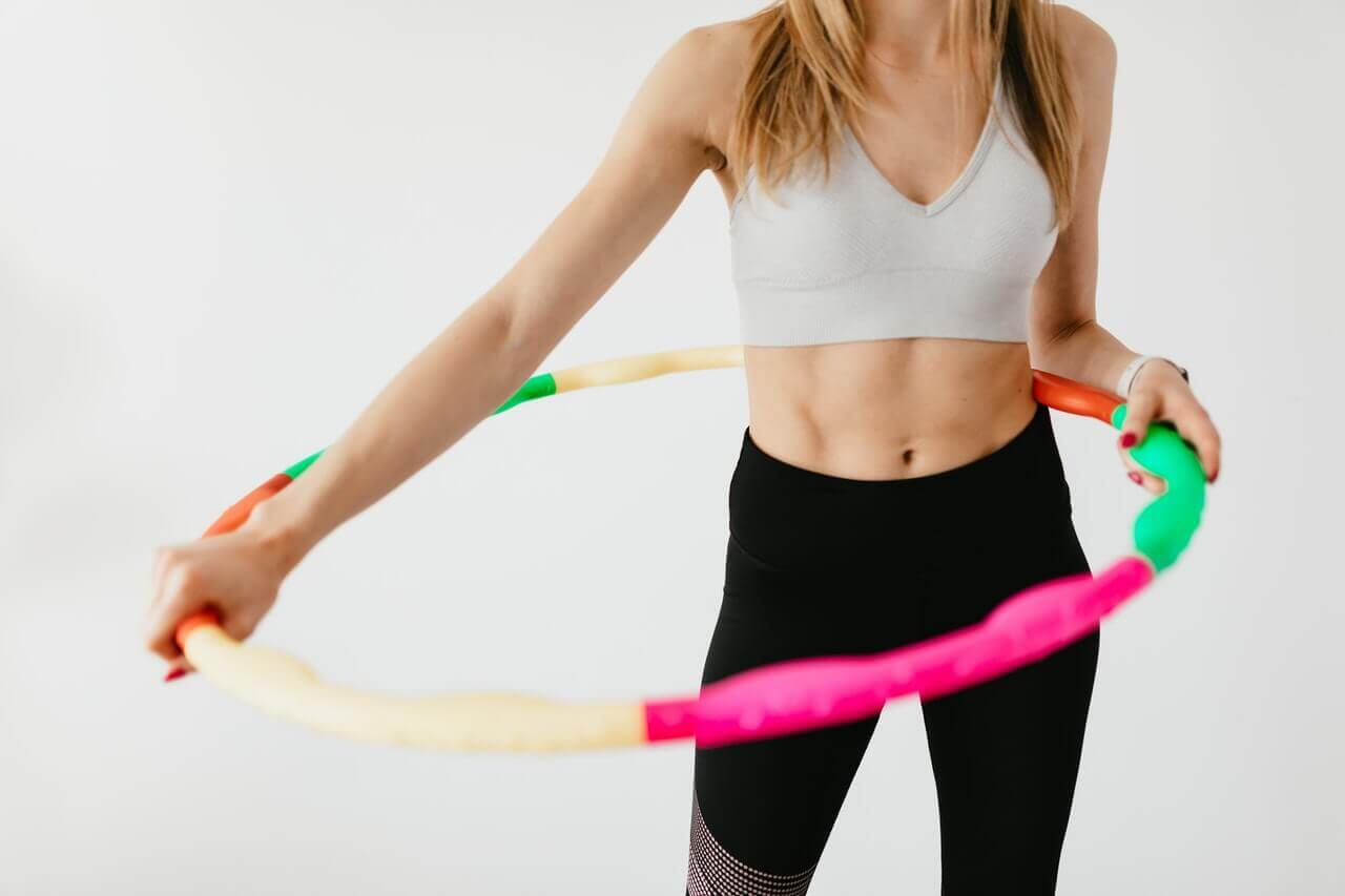 A woman using a hula hoop.