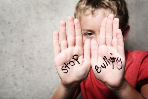 Boy with writing on hands stop school bullying