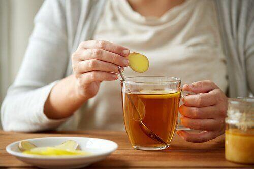 A woman making tea.