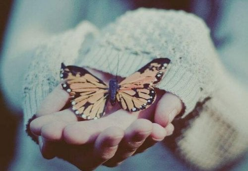 woman with butterfly in her hands