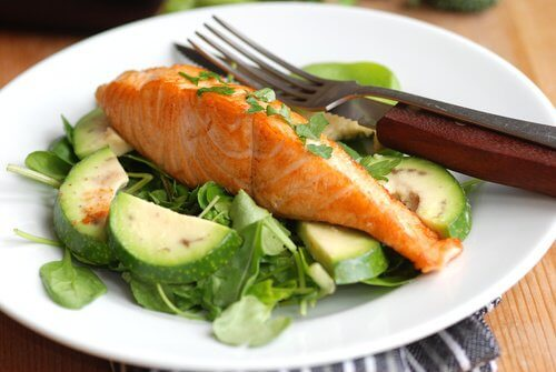 A plate of salmon and vegetables.