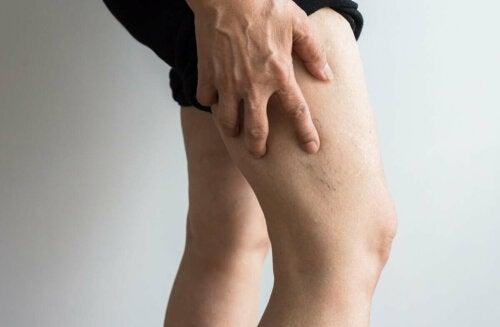 A person feeling their legs.