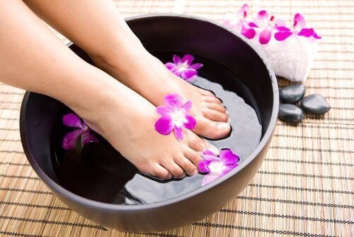 Woman with feet in a tub foot treatment beauty rituals antifungus