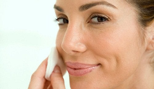 Woman cleansing facial skin beauty rituals