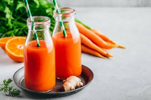 Two bottles of carrot and ginger juice.