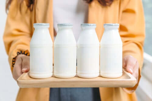 A woman holding dairy products.