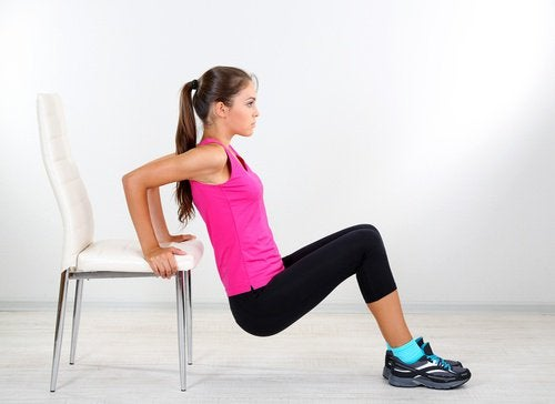 Woman using chair at home to work out triceps