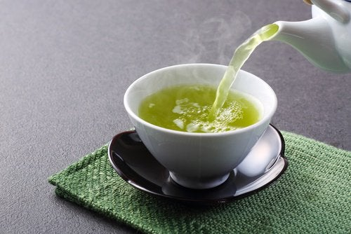 Pouring out a cup of green tea
