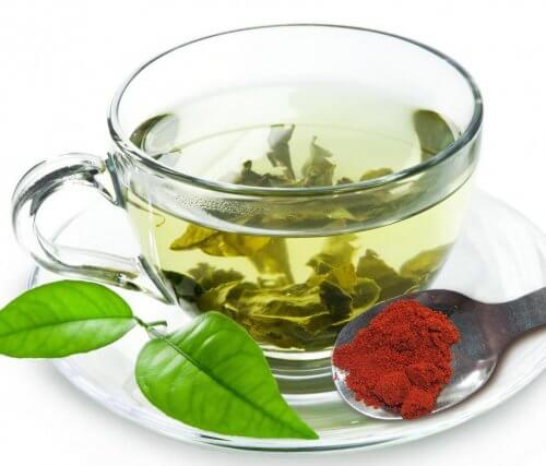Cup of green tea with spices