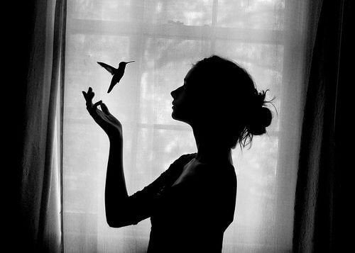 A woman with a humming bird.