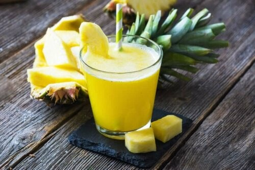 A pineapple natural fat-burning smoothie on a table.