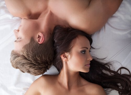 couple-fallen-on-the-bed-with-problems