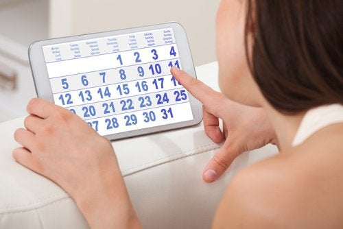 Woman looking at a calendar