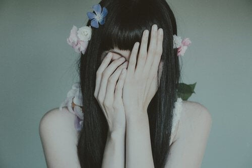 Sad girl covering her face