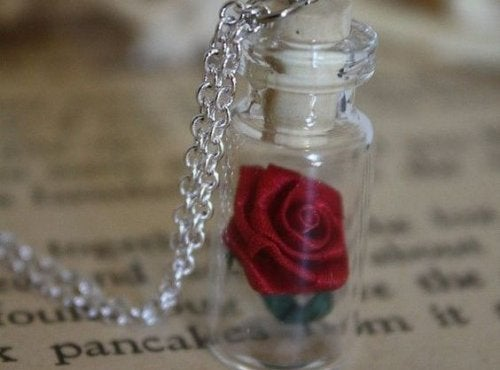 A rose in a bottle.