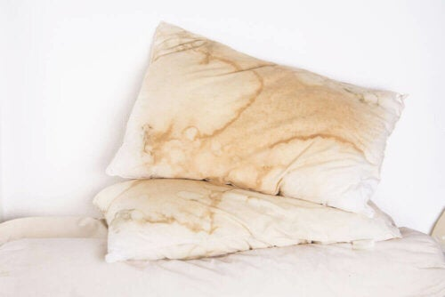 Some dirty pillows on a bed.