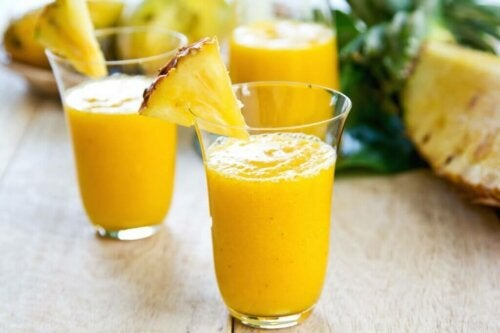 Some pineapple smoothies on a table.