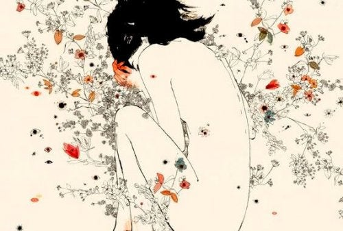 A drawing of a naked woman with flowers.