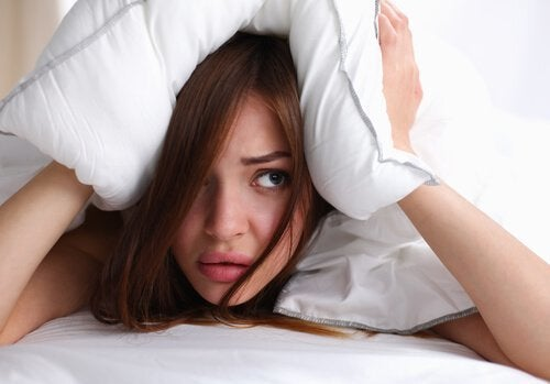 woman-with-pillow-over-her-head