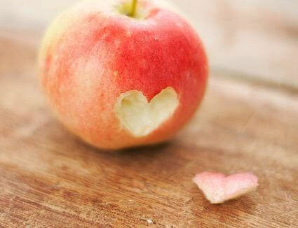 An apple with a heart shape.