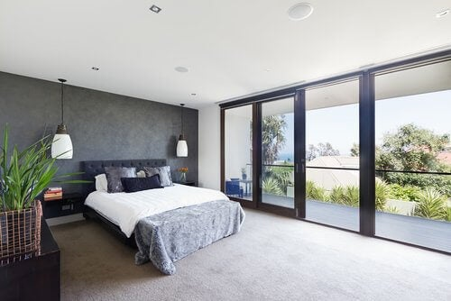 Seaview bedroom with beige carpet minimalist tropical island view
