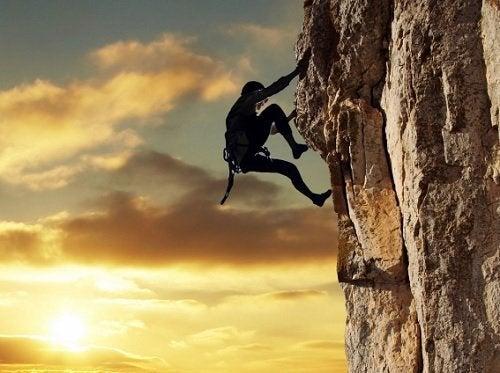 Man climbing up a cliff