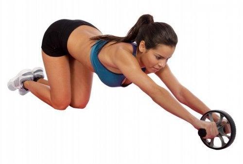 A woman doing wheel exercises.
