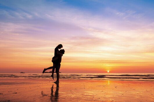 Couple in love dancing on a beach because age is just a number