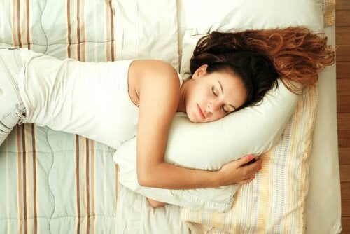 woman sleeping with pillows