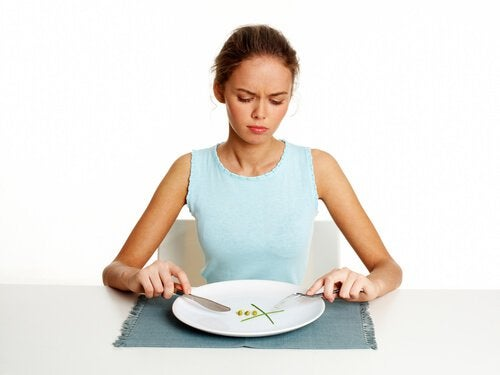 Woman with hardly any food on her plate