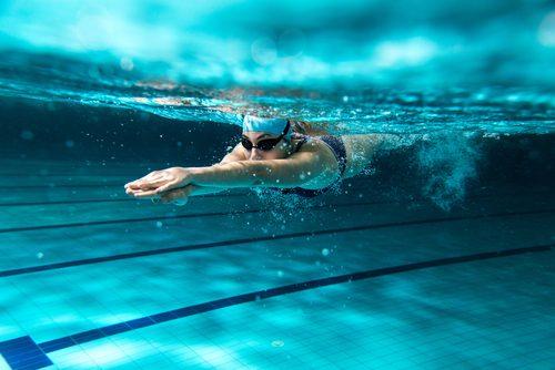Woman swimming underwater.