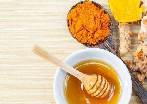 A bowl with honey and curcuma.