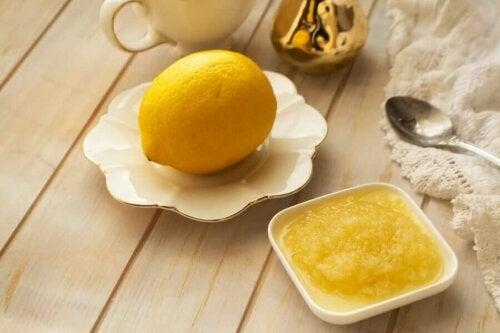 A lemon and lemon paste on a table.
