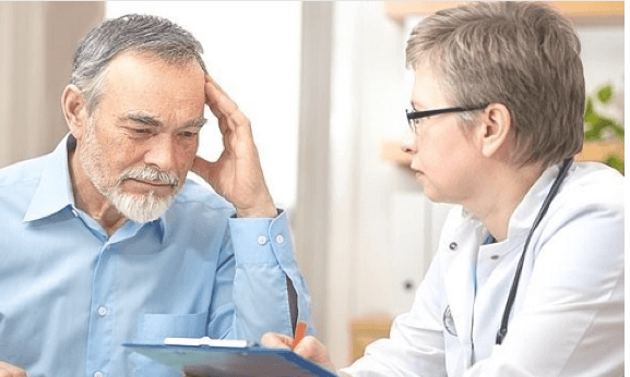A doctor speaking to a concerned man.