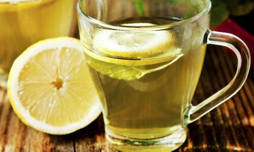 Water with lemon might help treat abdominal bloating.