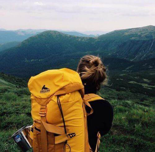 girl taking a backpacking trip